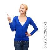 Купить «Молодая женщина нажимает на кнопки невидимого экрана», фото № 5292672, снято 17 октября 2013 г. (c) Syda Productions / Фотобанк Лори