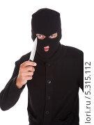 Купить «грабитель в маске держит нож», фото № 5315112, снято 24 августа 2013 г. (c) Андрей Попов / Фотобанк Лори