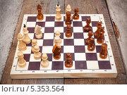 Купить «Шахматная доска с деревянными фигурами на полу», фото № 5353564, снято 23 ноября 2013 г. (c) Кекяляйнен Андрей / Фотобанк Лори