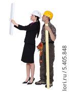 Купить «Девушка-архитектор показывает чертеж мастеру», фото № 5405848, снято 15 марта 2011 г. (c) Phovoir Images / Фотобанк Лори