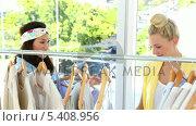 Купить «Pretty friends looking through clothing rail together», видеоролик № 5408956, снято 28 января 2020 г. (c) Wavebreak Media / Фотобанк Лори