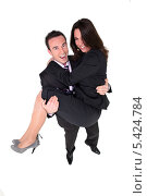 Купить «Бизнесмен держит свою коллегу на руках», фото № 5424784, снято 20 января 2010 г. (c) Phovoir Images / Фотобанк Лори