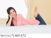 Купить «Pretty happy girl looking at camera lying on her bed», фото № 5460672, снято 22 мая 2013 г. (c) Wavebreak Media / Фотобанк Лори