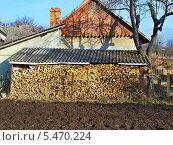 Купить «Дрова на зиму», фото № 5470224, снято 3 января 2014 г. (c) Александр Заболотный / Фотобанк Лори
