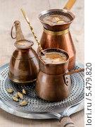 Купить «Кофе с кардамоном в турках», фото № 5479820, снято 22 ноября 2013 г. (c) Ирина Завьялова / Фотобанк Лори
