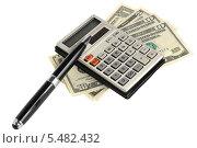Купить «Калькулятор с ручкой на долларах на белом фоне», фото № 5482432, снято 12 января 2014 г. (c) Алексей Карпов / Фотобанк Лори