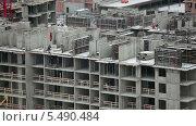 Купить «Возведение высотного дома. Стройплощадка», видеоролик № 5490484, снято 15 января 2014 г. (c) Кекяляйнен Андрей / Фотобанк Лори