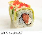 Купить «Японская кухня. Роллы с лососем, мягким сыром и икрой летучей рыбы крупно», эксклюзивное фото № 5508752, снято 20 января 2014 г. (c) Яна Королёва / Фотобанк Лори
