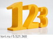 Купить «Желтый цифры 123 на белом фоне», фото № 5521360, снято 26 января 2014 г. (c) Александр Овчинников / Фотобанк Лори