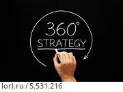 """Купить «Рука пишет мелом на доске по-английски: """"Стратегия 360 градусов""""», фото № 5531216, снято 19 августа 2012 г. (c) Ивелин Радков / Фотобанк Лори"""