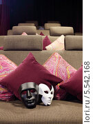 Купить «Две маски на мягком диване с подушками в маленьком театре», фото № 5542168, снято 4 сентября 2012 г. (c) Losevsky Pavel / Фотобанк Лори
