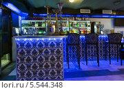 Купить «Барная стойка с тремя стульями и с синей подсветкой», фото № 5544348, снято 30 декабря 2012 г. (c) Losevsky Pavel / Фотобанк Лори
