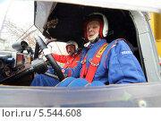 Купить «Экипаж в кабине гоночного автомобиля на ралли Rally Masters Show в Москве», фото № 5544608, снято 21 апреля 2012 г. (c) Losevsky Pavel / Фотобанк Лори