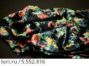 Купить «Чёрная ткань с яркими цветными рисунками», фото № 5552816, снято 14 августа 2013 г. (c) Morgenstjerne / Фотобанк Лори