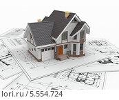 Купить «Макет жилого домика на чертежах», иллюстрация № 5554724 (c) Maksym Yemelyanov / Фотобанк Лори