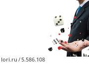 Купить «Бизнесмен подбрасывает игральные кости», фото № 5586108, снято 14 июля 2020 г. (c) Sergey Nivens / Фотобанк Лори