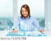 Купить «Девушка нажимает на виртуальные кнопки на столе», фото № 5610768, снято 20 декабря 2013 г. (c) Syda Productions / Фотобанк Лори