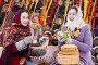 Купить «Девушки за праздничным столом едят угощения.Масленица», фото № 5611424, снято 19 ноября 2017 г. (c) Елена Ермакова / Фотобанк Лори