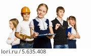 Купить «Школьники на белом фоне позируют с атрибутами будущей профессии», фото № 5635408, снято 20 июля 2018 г. (c) Sergey Nivens / Фотобанк Лори