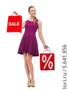 Купить «Красивая девушка в платье на высоких каблуках во время скидок в магазине», фото № 5641856, снято 12 февраля 2014 г. (c) Syda Productions / Фотобанк Лори