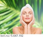 Купить «Красивая девушка с полотенцем на голове касается пальцами нежной кожи на лице», фото № 5647192, снято 5 декабря 2013 г. (c) Syda Productions / Фотобанк Лори