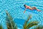 Брюнетка в красном купальнике загорает на надувном матрасе в небольшом плавательном бассейне, фото № 5650024, снято 13 июля 2012 г. (c) Losevsky Pavel / Фотобанк Лори