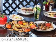 Купить «Аппетитные блюда на столе в ресторане», фото № 5650816, снято 31 марта 2012 г. (c) Losevsky Pavel / Фотобанк Лори
