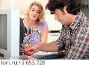 Купить «мастер чинит телевизор», фото № 5653728, снято 8 октября 2010 г. (c) Phovoir Images / Фотобанк Лори