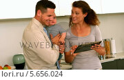 Купить «Parents using tablet pc while father holds baby», видеоролик № 5656024, снято 23 августа 2019 г. (c) Wavebreak Media / Фотобанк Лори