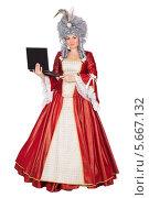 Купить «Женщина в платье королевы с ноутбуком», фото № 5667132, снято 13 декабря 2013 г. (c) Сергей Сухоруков / Фотобанк Лори