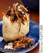 Купить «рисовый мешочек с морковным салатом крупным планом», фото № 5677260, снято 17 ноября 2010 г. (c) Food And Drink Photos / Фотобанк Лори