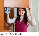 Купить «Девушка протирает шкафы от пыли», фото № 5680376, снято 17 января 2014 г. (c) Яков Филимонов / Фотобанк Лори