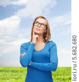 Купить «Счастливая девушка думает о чем-то на фоне поля под голубым небом», фото № 5682680, снято 5 декабря 2013 г. (c) Syda Productions / Фотобанк Лори