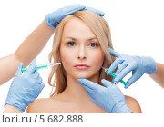 Купить «Косметологи делают уколы в женское лицо», фото № 5682888, снято 7 января 2014 г. (c) Syda Productions / Фотобанк Лори