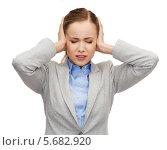 Купить «Уставшая офисная сотрудница держится за голову», фото № 5682920, снято 19 января 2014 г. (c) Syda Productions / Фотобанк Лори