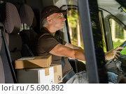 Купить «Довольный водитель-экспедитор за рулем», фото № 5690892, снято 7 августа 2013 г. (c) CandyBox Images / Фотобанк Лори