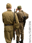 Купить «Два солдата с автоматами на белом фоне», фото № 5691516, снято 22 мая 2019 г. (c) Георгий Хрущев / Фотобанк Лори
