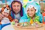 Мужчина с двумя детьми в карнавальных костюмах сидят за столом с пиццей, фото № 5693288, снято 16 августа 2013 г. (c) Losevsky Pavel / Фотобанк Лори