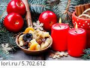 Купить «Тарелка с сухофруктами и зажженные красные свечи», фото № 5702612, снято 19 апреля 2019 г. (c) BE&W Photo / Фотобанк Лори