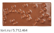 Купить «Плитка молочного шоколада с орехами», фото № 5712464, снято 25 июня 2019 г. (c) Владимир Красюк / Фотобанк Лори