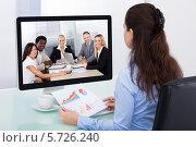 Купить «деловая женщина участвует в видеоконференции», фото № 5726240, снято 13 октября 2013 г. (c) Андрей Попов / Фотобанк Лори