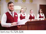 Купить «Портье с папкой  в отеле Bogorodino, Москва», фото № 5729324, снято 22 мая 2013 г. (c) Losevsky Pavel / Фотобанк Лори