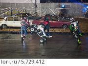 Купить «Три каскадеров едут на задних колесах мотоциклов на шоу Monster Mania в «Олимпийском»», фото № 5729412, снято 23 марта 2013 г. (c) Losevsky Pavel / Фотобанк Лори