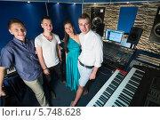 Купить «Трое парней и девушка певица в студии звукозаписи с оборудованием», фото № 5748628, снято 25 декабря 2012 г. (c) Losevsky Pavel / Фотобанк Лори