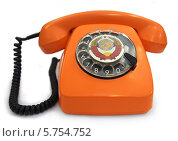 Купить «Оранжевый телефон 60-70 годов с гербом СССР на диске», фото № 5754752, снято 20 декабря 2013 г. (c) Ельцов Владимир / Фотобанк Лори