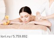 Купить «Расслабленная молодая женщина на сеансе массажа в СПА-салоне», фото № 5759892, снято 4 мая 2013 г. (c) Syda Productions / Фотобанк Лори