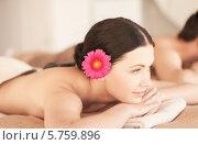 Купить «Женщина с цветком в волосах в СПА-салоне на стоун-терапии», фото № 5759896, снято 4 мая 2013 г. (c) Syda Productions / Фотобанк Лори