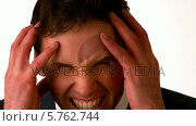 Купить «Angry businessman putting hands on head», видеоролик № 5762744, снято 19 июня 2019 г. (c) Wavebreak Media / Фотобанк Лори