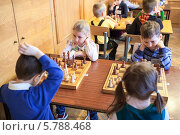 Купить «Дети играют в шахматы. Районный шахматный турнир среди дошкольников. Санкт-Петербург», фото № 5788468, снято 24 марта 2014 г. (c) Кекяляйнен Андрей / Фотобанк Лори