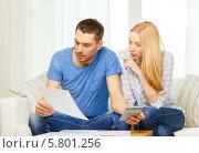 Купить «Муж и жена с квитанциями в руках считают на калькуляторе расходы на оплату квартиры», фото № 5801256, снято 9 февраля 2014 г. (c) Syda Productions / Фотобанк Лори